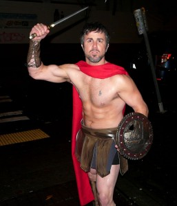 Young man dressed as a gladiator.