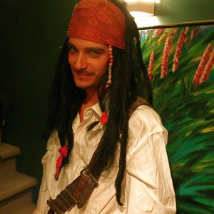 Attractive young man dressed as a pirate.
