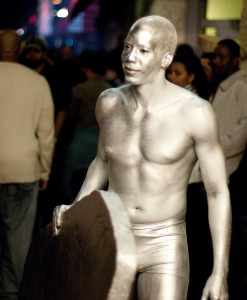 Young man in silver body paint.