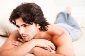 Attractive young man lying down