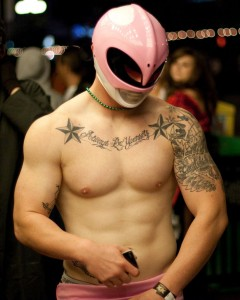 Muscular young man dressed as the pink Power Ranger