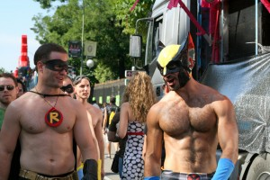 Two hot guys dressed as super heroes.