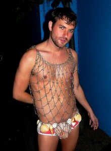 Attractive young man dressed as a merman.